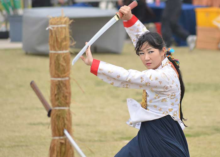 Woman holding Korean sword.